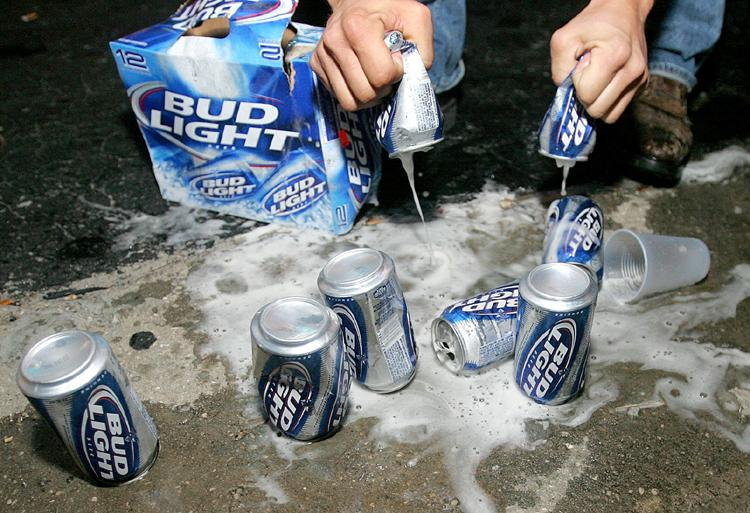 Beer is poured out after underage drinkers were busted by the Panama City Beach Police Department.