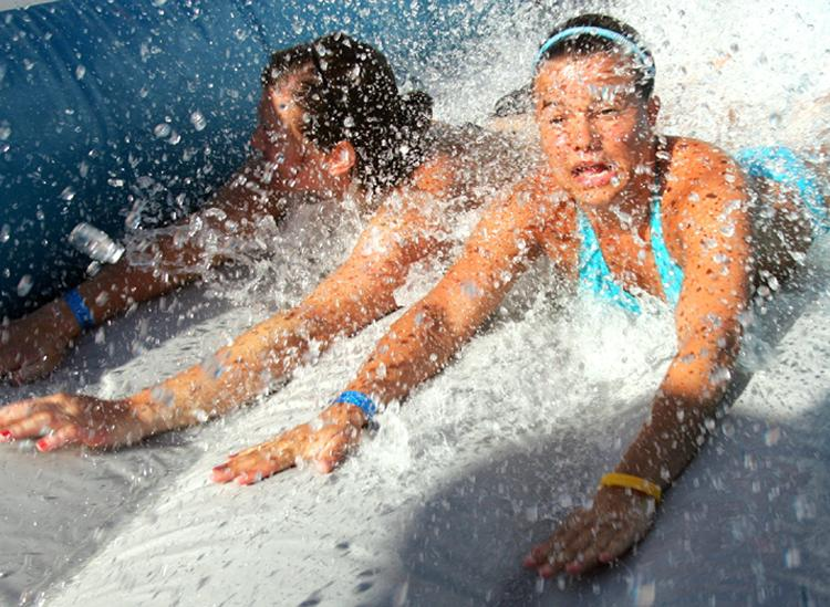 Spring breakers slide down a water slide on Panama City Beach.