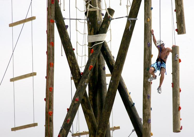A spring breaker takes on the ropes course near the Holiday Inn Sunspree Resort in Panama City Beach.