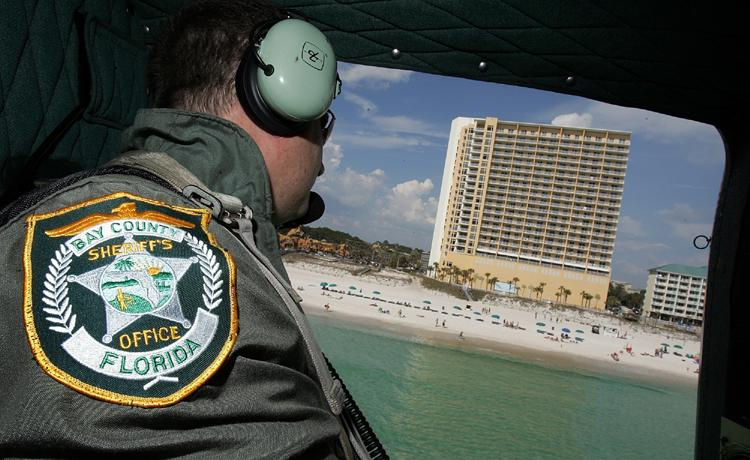 Dept. Chad Harrell scopes out the beach from the Bay County Sheriff's Helicopter.