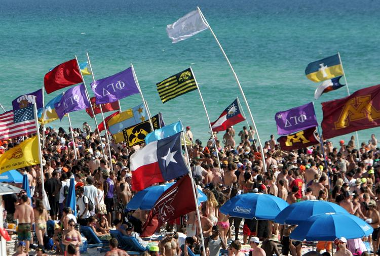 A sea of Spring Breakers and flags dot the skyline in Panama City Beach.