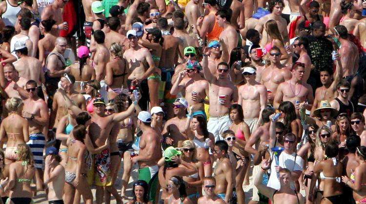 Spring Breakers crowd the beach in Panama City Beach.