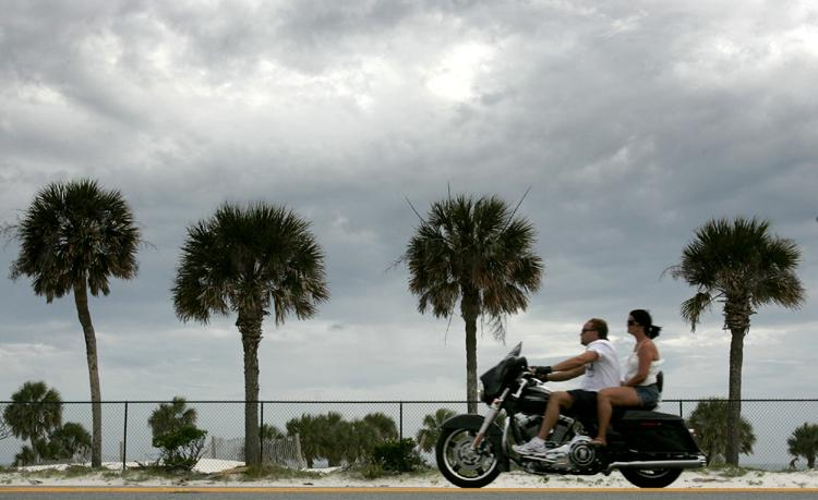 Bikers cruise the beach during the spring Thunder Beach motorcycle rally in Panama City Beach. (Andrew Wardlow/Panama City News Herald)